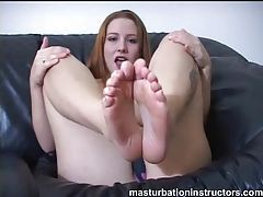 Redhead in a hot solo foot tease tubes