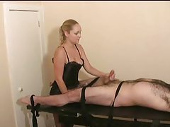 Sexy blonde in lingerie gives little cock a handjob tube