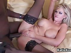 Slutty blonde chick with black stockings gets her pussy fucked hard by black cock tubes