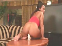 Muscular girl sits on a toy solo tubes