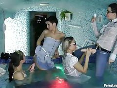 Clothed lesbian dildo play in hot tub tubes