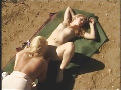 Lesbians lick pussy and nipples in the desert tubes