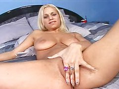 Blonde girl plays with her big natural tits tubes