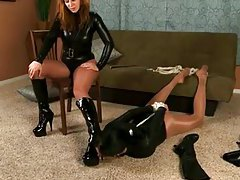Kinky lesdom scene with latex and leather tubes