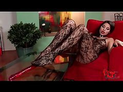 Glamorous girl in beautiful body stocking sucks her toes tubes