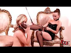 Girl in collar and leash licks high heels and feet tubes