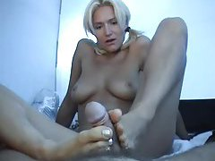 Slim chick in pigtails gives POV footjob tubes