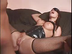 Leather corset and fishnets on fucked brunette tubes