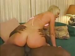 Pink bikini slut takes black cock up the ass tubes
