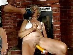 Hairy cunt granny masturbates with toys tubes