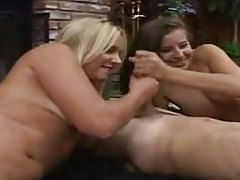 Sexy girls take turns sucking that big cock tubes