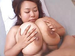 Fucking her gigantic Japanese tits tubes