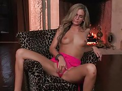 Pretty girl with little tits rubs her pussy tubes