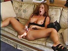 Beauty in short skirt toys her pussy tubes