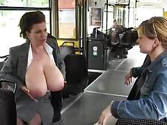 Chick milks her huge tits on a public bus tubes