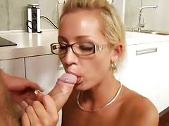 Beauty in classy glasses sucks on cock tubes