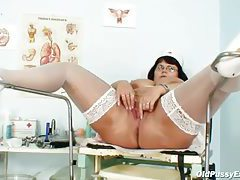 Chubby mature nurse toy fucks her cunt tubes