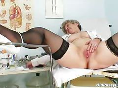 Granny with shaved cunt shows it off tubes
