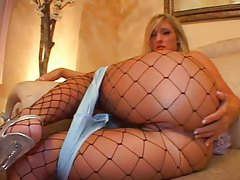 Cute blonde minx in stockings fingers her pussy tubes