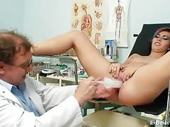Speculum in the pussy with a light following tubes