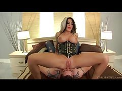 Dominant latex girl sits on his face tubes