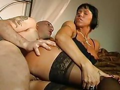 Naughty cougar in sexy black lingerie gets boned tubes