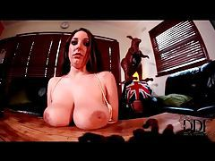 Funny brunette plays with her really big tits tubes