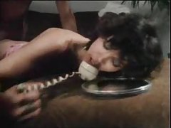 Chick on phone fucked in vintage video tubes