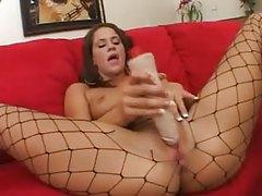 Sensual slut in fishnets dildo fucking tubes