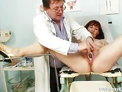 Doctor makes mature pussy wet with milk tubes