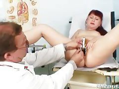 Mature redhead and her doctor have some fun tubes