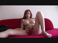 Pierced redhead enjoys a smoke whilst naked tubes