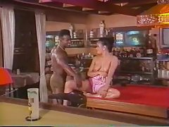 Retro babe gets her hairy pussy filled with black dick tubes