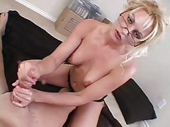 Saucy blonde milf with glasses teasing dick with her hands tubes