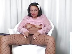 Big booty brunette teasing in fencenet pantyhose tubes