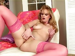 Busty blonde in a bra sexy panties and stockings tubes