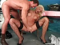 Chick with fake titties laid and he pisses on her tubes