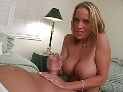 Busty blonde hottie gives her man a hard handjob tubes