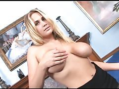 Busty blonde MILF teases in sheer black pantyhose tubes