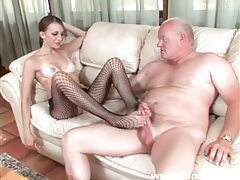 Saucy minx with fishnet stockings gives foot fuck tubes