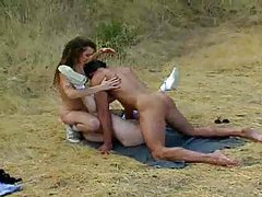 Threesome sex in the grass tubes