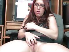 Nerdy redhead with glasses rubs her moist pussy tubes