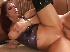 Mature redhead in latex boots gets a hard ass pounding tubes