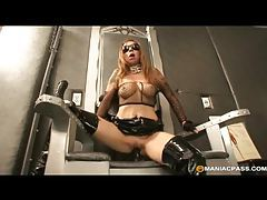 Solo tattooed girl in latex fucks with a toy tubes