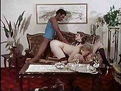 Two blonde retro babes share big black cock tubes