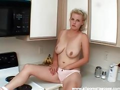 Busty blonde hottie fingering herself in the kitchen tubes