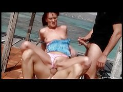 Slut on an island beach banged in threesome tubes