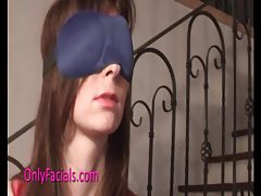 Girl in a pink dress in bondage and blindfold tubes