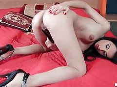 Babe with jet black hair sticking things down her pussy tubes