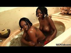 Sexy ebony lesbian duo using toys in the tub tubes